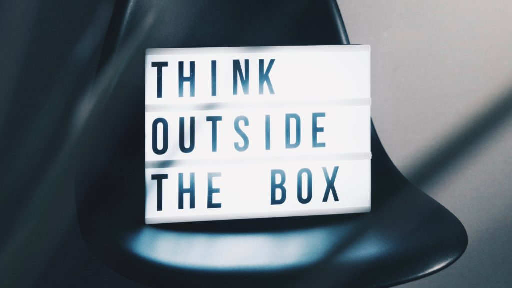 Chair with Think Outside the Box Sign